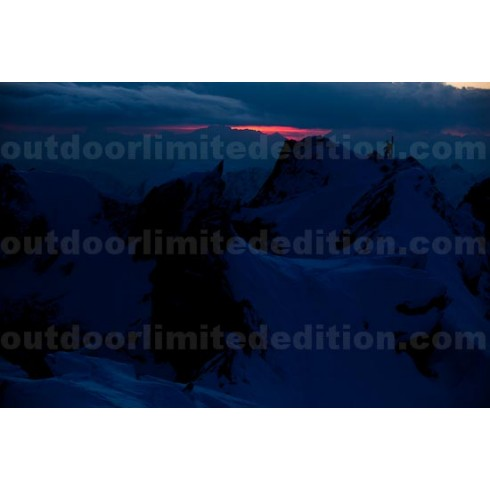 Mountaineer climbing in sunset