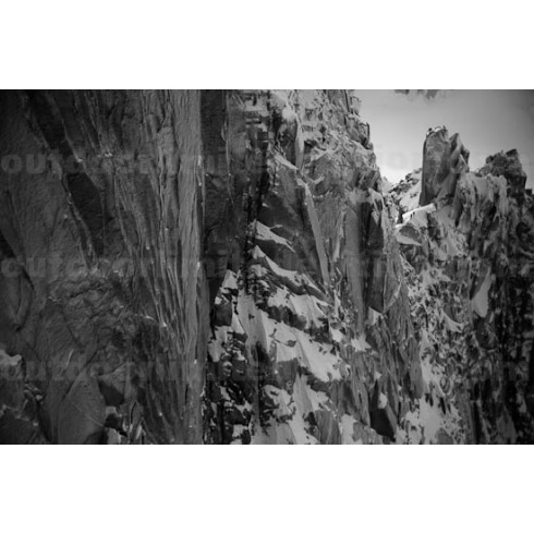 Mountaineer climbing Arete des cosmiques